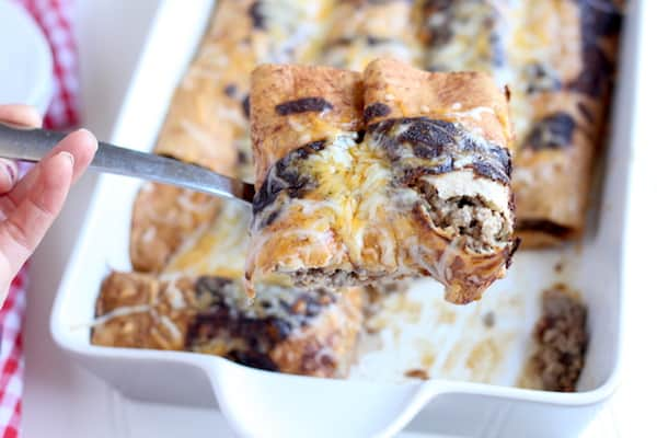 Servinghomemade cheeseburger enchiladas