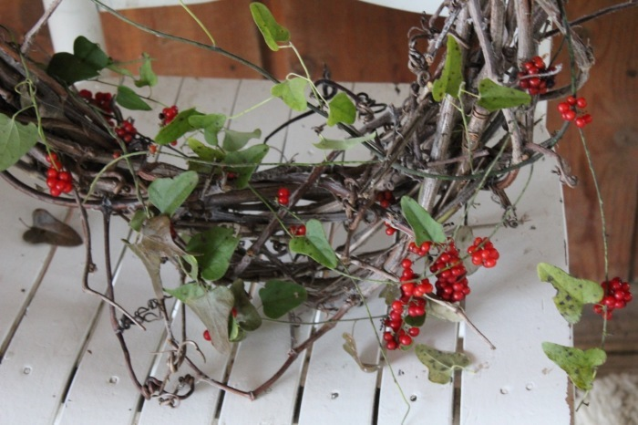 red berries on grapevine wreath