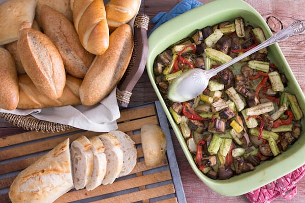 Healthy roasted fresh vegetables with bread rolls
