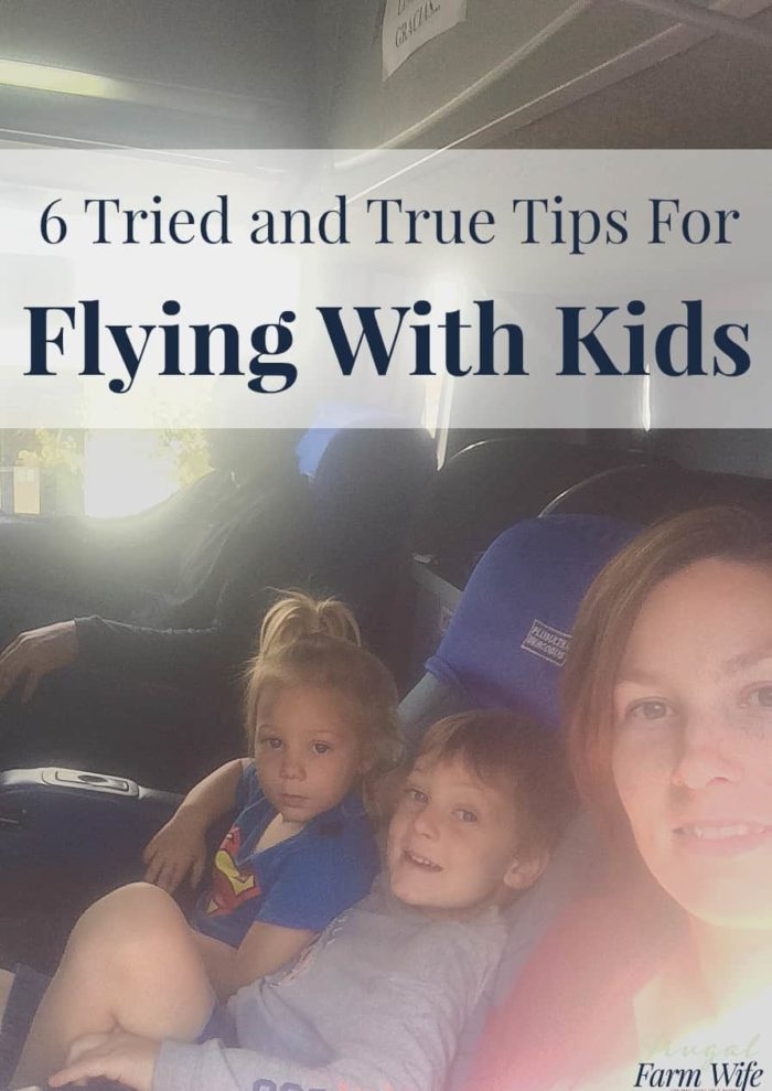 These six tried and true tips for flying with kids will make your travels 100x easier!