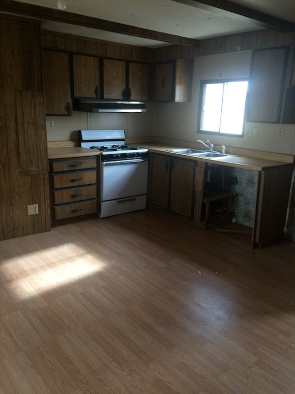 This kitchen will definitely need a lot of love! Just one of the issues with buying an old mobile home that this blogger is about to tackle!