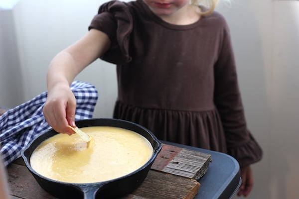 little girl dipping chip into gluten-free cheese sauce