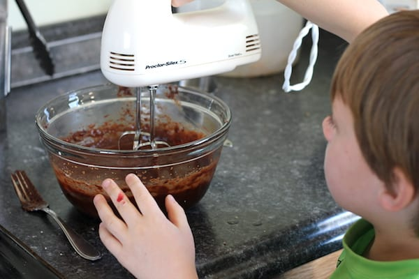 child making coconut flour brownies