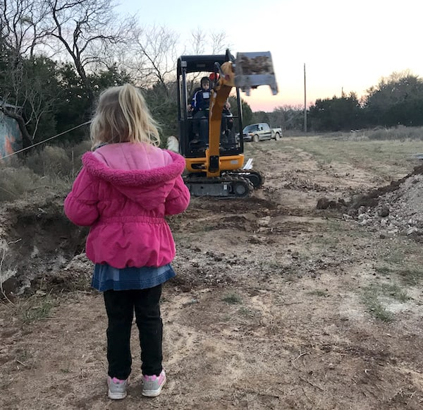 digging pit with a backhoe