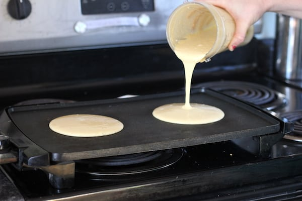 putting banana oat pancakes on the griddle