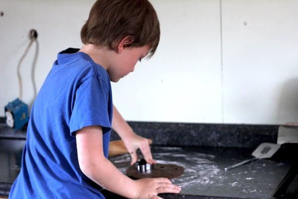 cutting gluten-free gingerbread cookies