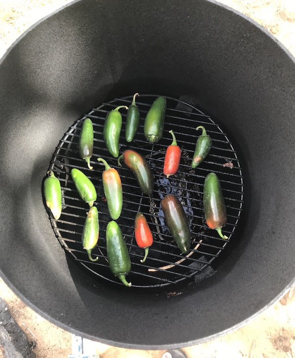 jalapeño chipotle peppers on the smoker