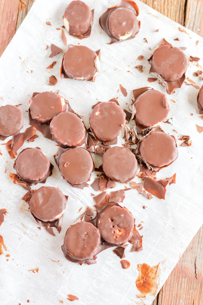 chocolate covered banana slices on parchment paper
