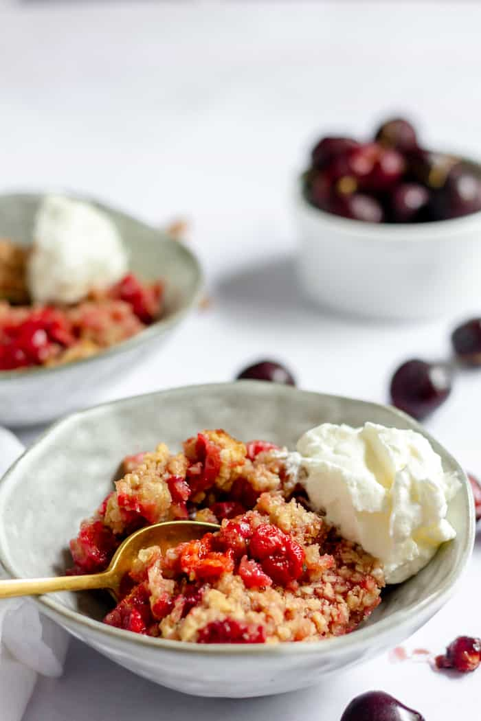 cherry crips topped with whipped cream - perfect summer dessert!