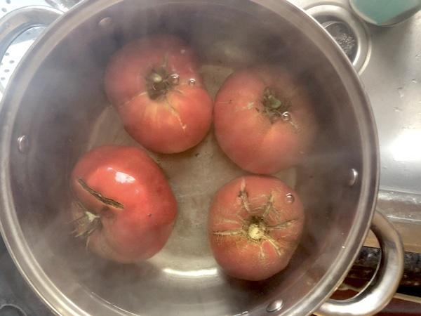 peeling tomatoes in hot water
